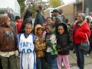 Detroit children wait for free coats given away by the Moorish Science Temple of America