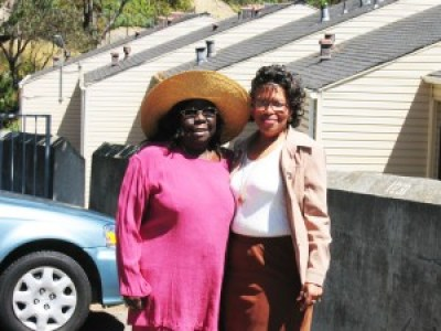 In July 2006, Espanola and Lisa Shelby stand outside the LaSalle Apartments, one of the HUD-subsidized complexes she and the Big Five won for the people of Bayview Hunters Point. Years later, in the early '90s, she led a revolutionary movement to implement a little known federal law enabling residents of public and subsidized housing to take over management and ultimately own their complexes as co-ops. Under her leadership, San Francisco pushed the process further than in any other city, but the movement was brutally put down. That was when the youth, their dreams destroyed, responded to the simultaneous invasion of crack into the hoods with turf wars.