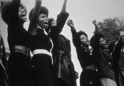 This is the iconic photo of Black Panther women of the Sacramento chapter singing at a Free Huey rally. – Photo: Pirkle Jones
