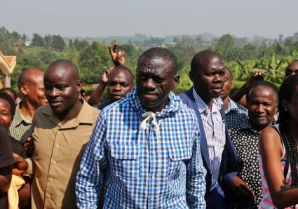 "Looking apprehensive, Dr. Kizza Besigye arrives at a polling station to vote in his home town of Rukungiri, 400 km west of Kampala on Feb. 18. He soon learned of a polling place nearby that was being manned by the police and the NRM, the party of President Museveni. ""He walked in and saw them pre-ticking ballot papers. They arrested him and took him to an unknown place,"" said Shawn Mubiru, senior official with Dr. Besigye's party, the Forum for Democratic Change, FDC. As usual on the frequent occasions when he is arrested, he was soon released. – Photo: AFP"
