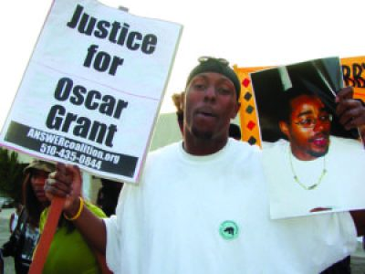 A march honoring Lovelle Mixon in his East Oakland neighborhood on March 25, 2009, coupled Lovelle's police murder with Oscar Grant's. – Photo: Dave Id, Indybay
