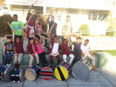 This photo shows not only a lot of music-making, fun-loving kids but also their duct-taped Urban Tambora or Slap Drums.