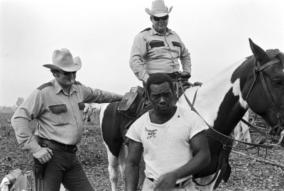 Prisons in Texas are, like Angola in Louisiana, former plantations. As prisons, they are still today worked by enslaved people, people who get no pay, not even credit to shorten their sentences. This is the Cummins Prison Farm, 1975. – Photo courtesy The Marshall Project