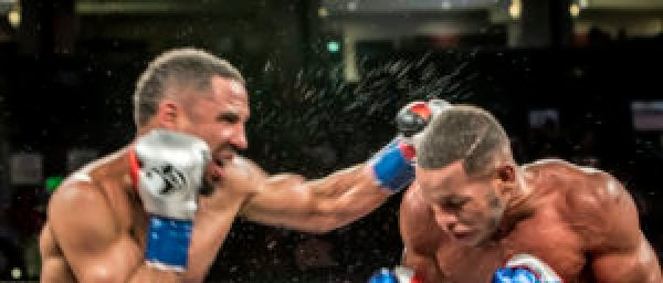 2531 - Swift, powerful left hooks, jabs and straight right hand punches by Andre Ward characterized his defense and offense. Sullivan Barrera missed a lot. Andre Ward didn't. – Photo: Malaika H Kambon