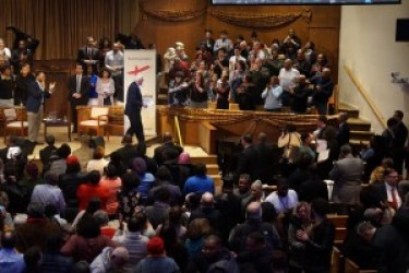 As Sen. Sanders left, the audience rose to its feet for the last of several standing ovations. – Photo: Rhonda Crowder