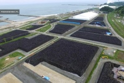 "This drone's eye view shows some of the millions of sacks of contaminated soil in Fukushima. When photographer and filmmaker Arkadiusz Podniesiński went to Fukushima last year to see how the cleanup process compared to Chernobyl. He reports: ""Twenty thousand workers are painstakingly cleaning every piece of soil. They are removing the top, most contaminated layer of soil and putting it into sacks to be taken to one of several thousand dump sites. The sacks are everywhere. They are becoming a permanent part of the Fukushima landscape."" – Photo: Arkadiusz Podniesiński"