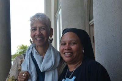 Ericka Huggins, director from 1973 to 1981of the Oakland Community School, founded by the Black Panther Party, and now a college professor, stands with Beatrice X of the Love Not Blood Campaign and co-organizer of the Oscar Grant Legacy Weekend. – Photo: Love Not Blood Campaign