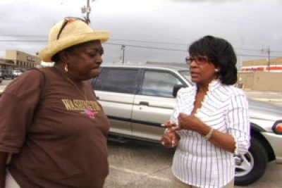 """Sharon Jasper, leader of the """"Bring the People Home"""" movement to allow 4,500 New Orleans families to return to their perfectly livable public housing apartments after Katrina, most untouched by the flood, discusses strategy with Congresswoman Maxine Waters, the only member of Congress who devoted herself to enabling poor New Orleanians to recover. Despite their brilliant and valiant efforts, public housing was almost entirely demolished in New Orleans. In the years since then, city after city has privatized and/or demolished its public housing, driving thousands of residents – families, the elderly and the disabled – into homelessness."""