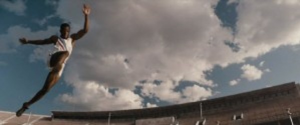 "Stephan James as Jesse Owens leaps in the movie ""Race."""