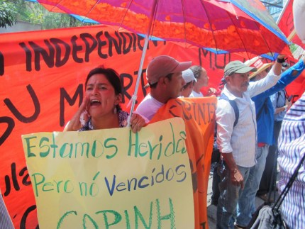 """""""We are hurt but not defeated, COPINH,"""" the sign reads. – Photo: Jeanette Charles"""