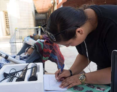 Woman signs a petition calling upon the Israeli army not to close its investigation into the death of Toveet Radcliffe. – Photo: Dan Cohen