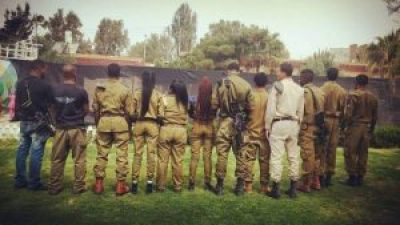 African Hebrew soldiers turn their backs to the camera, since they are not allowed to publicly protest while they are still serving. This photo was circulated online by Hebrew youth with a call to refuse enlistment.