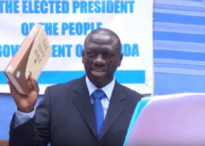 Dr. Kizza Besigye held the Holy Bible and swore in as the president of Uganda on May 11, 2016. Yoweri Museveni's security forces arrested him three hours later. Dr Besigye has since been charged with treason.