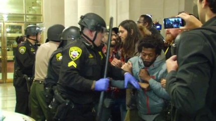 Thirty-three were arrested, many brutally, during the Frisco 500 occupation of City Hall from 4 p.m. to nearly 11 p.m. on Friday, May 6. Their aim was to hold City Hall until Police Chief Greg Suhr is fired. – Photo: KGO-TV
