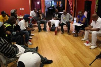 Adimu Madyun, right, facilitates a DetermiNation meeting of young Black men in Oakland.