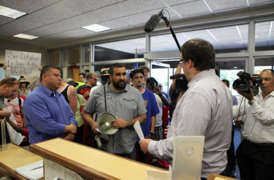 On June 21, supporters marched to the headquarters of the Wisconsin Department of Corrections in Madison to deliver a letter to DOC Secretary Jon Litscher. Readers are encouraged to contact Litscher to urge him to meet and negotiate with the striking prisoners. – Photo: Coburn Dukehart, Wisconsin Center for Investigative Journalism