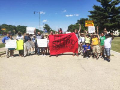 """""""Dying to Live"""" hunger strikers' supporters stop to pose for this picture before delivering their letter to Wisconsin DOC Secretary Jon Litscher in Madison on June 21. The prisoners are willingly starving themselves to end solitary confinement."""