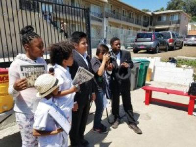 At the Emergency Press Conference on May 26, Deecolonize students Zair, Aselah, Amir, Kimo, Tibu and Tyray present their BlackArthur WeSearch articles published in the new issue of their skool and community newspaper, Decolonewz. – Photo: Tiny, Poor News Network