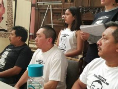 Family and supporters of the Justice and Honor for Luis Góngora Pat Coalition listen stoically at John Burris' law firm's press conference at St. John the Evangelist Church in the Mission June 17. – Photo: Poor News Network