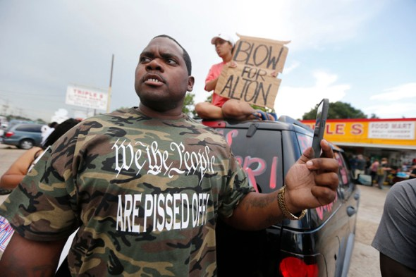 An angry Charley Roggerson, standing in the parking lot where Alton Sterling had been murdered by police only hours earlier, is typical of the outrage in Baton Rouge and across the country. – Photo: Gerald Herbert, AP