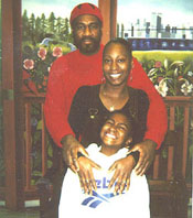 Three generations of Jalil's family line up in 2000: Jalil, his daughter Antoinette and his granddaughter Shacari.