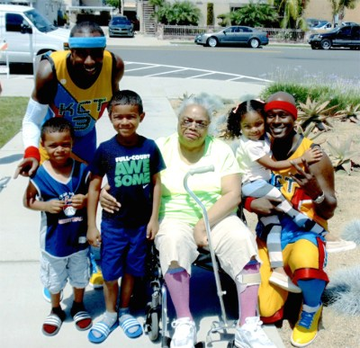 The young men on the left and right are members of the King Charles Unicycle Troupe, started in Brooklyn, N.Y., in 1964 and signed as the first African American act of Ringling Bros. Circus in 1969. With them, left to right, are Morris's grandkids, Marcelo, 4, Isaiah, 6, his wife, known as Mima to the kids, and finally Amaya, 3.