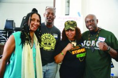 At the State of Black Oakland conference last year, Dafina Kuficha, Naru and Beatrice and Uncle Bobby Johnson posed for this photo by the late great photographer, Kamau Amen-Ra.