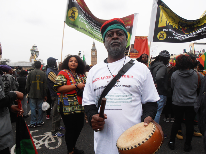 https://i0.wp.com/sfbayview.com/wp-content/uploads/2016/08/London-Reparations-March-Baba-Jahahara-on-Westminster-Bridge-3-min.-silence-for-ancestors-080116-by-Jahahara-web.jpg