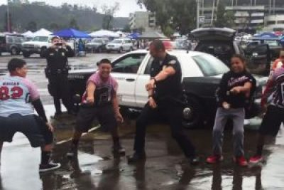 "A San Diego cop dances the Whip Nae Nae with the kids ""to help community relations."""
