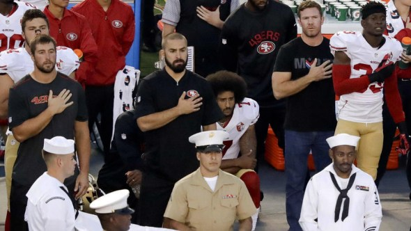 Kaepernick invited former Green Beret Nate Boyer, standing to Kaepernick's left, to join him at Thursday's San Diego game after Boyer invited the 49ers QB to discuss his views in an open letter to the Army Times. They talked for 90 minutes before the game. – Photo: Chris Carlson, AP
