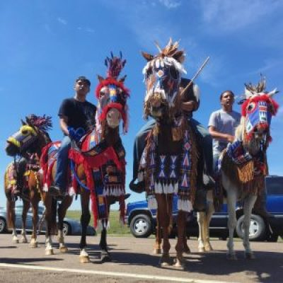 Horses and riders from the Rosebud Sioux Tribe's reservation in South Dakota arrive to support the Standing Rock community in North Dakota. The horses are dressed in traditional Lakota regalia. – Photo: Daniella Zalcman