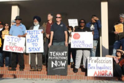 "Richmond renters and their supporters rally Sept. 13 before the City Council meeting to urge the council to vote ""yes"" on the moratorium against rent increases and evictions. – Photo: Abner Hauge, Richmond Confidential"
