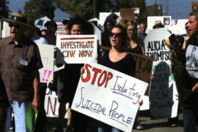 """""""Stop isolating suicidal people"""" was a major message delivered by hundreds of protesters who traveled from around California to the infamous California Institute for Women (CIW) state prison near Los Angeles to protest conditions that have caused a spate of suicides and for a vigil in remembrance of recent victims. – Photo: California Coalition for Women Prisoners (CCWP)"""