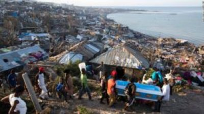 Friends of a pregnant woman killed by Hurricane Matthew carry her coffin through the rubble that remains of their homes in Jeremie, Haiti, on Oct. 7. – Photo: Dieu Nalio Chery, AP