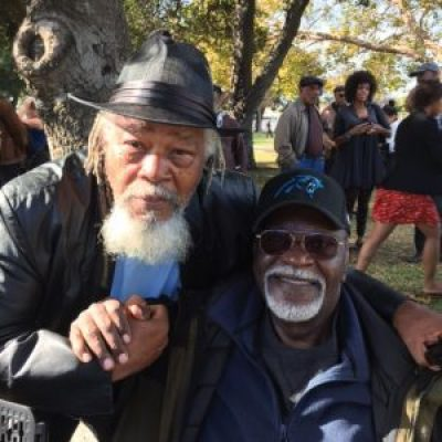 "Two powerful Panthers at the Bobby Hutton Grove dedication are Malik Rahim, founder of Common Ground in New Orleans, and Elbert ""Big Man"" Howard, founder of PACH in Sonoma County. – Photo: Carole Hyams Howard"