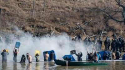 Earlier this month, on Nov. 2, before the real cold weather moved in, water protectors crossed a creek – some in canoes but most swimming – to land owned by the pipeline company. They were met by a line of police firing a wall of pepper spray at them so they couldn't leave the water. – Photo: Reuters