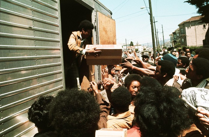 Black-Panthers-distribute-food-in-Oakland-in-1971-by-Sal-Veder-AP, Long live the greatest threat to the internal security of the US, the Black Panther Party!, Culture Currents