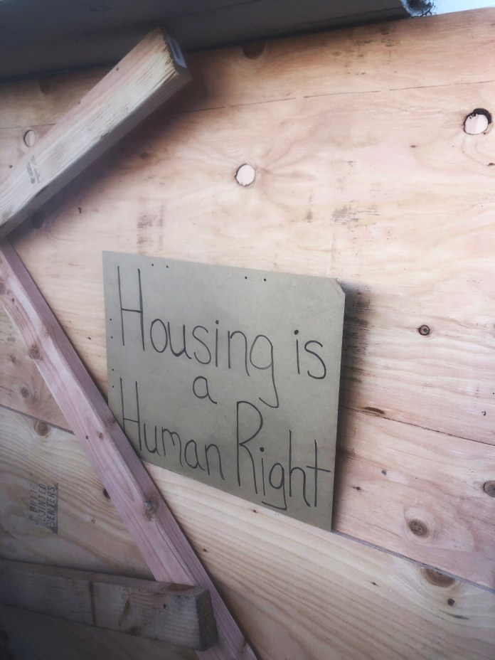 Moms-4-Housing-Housing-is-a-human-right-sign-on-boarded-up-window-by-PNN, Moms 4 Housing: Un-Wedgewooding the world must be led by Mama Power, Local News & Views World News & Views