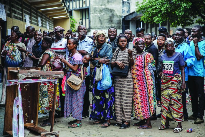 Congolese-voters-line-up-in-Kinshasa-123018-by-Luis-Tato-AFP, Is Rwanda under Kagame a shining example of good news from Africa?, World News & Views