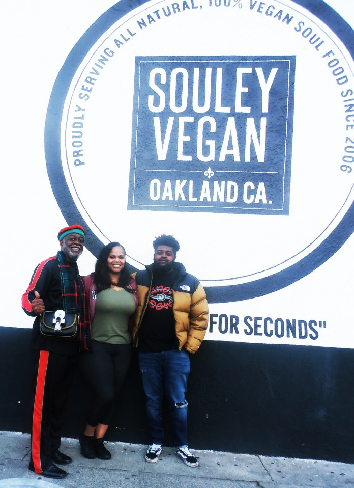 Jahahara-son-Chioke-Bakari-flank-Tamearra-Dyson-owner-of-Souley-Vegan-3rd-Broadway-Oakland-0120-by-Jahahara, Claiming our African stories, victories and future!, Culture Currents