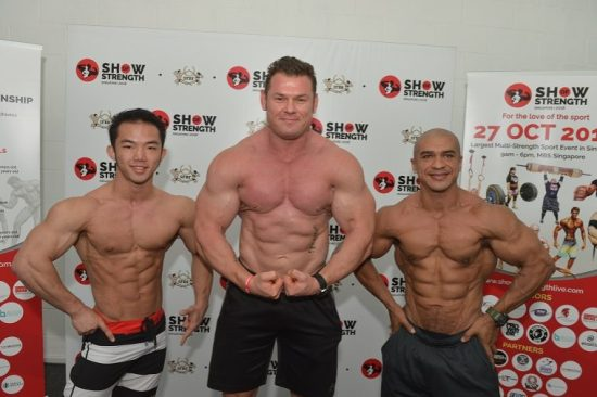 7 SFBF President Alex Michael Betts flanked by competing athletes Roy Chua left and Daniel Lino right