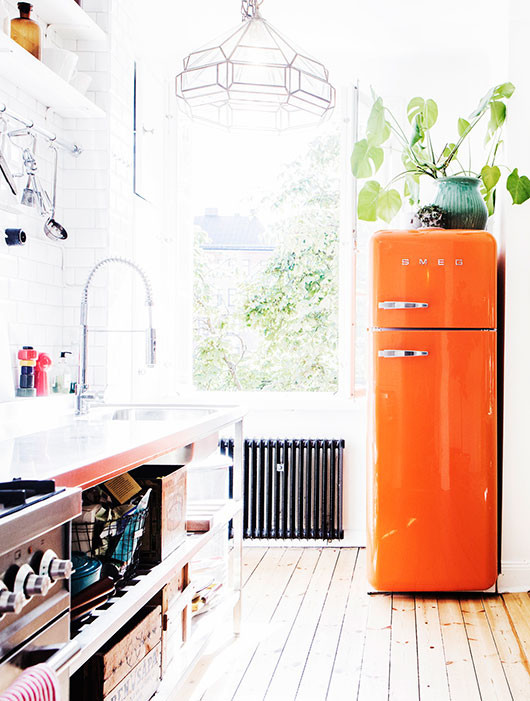 bright orange smeg inside elsa billgren's home / sfgirlbybay