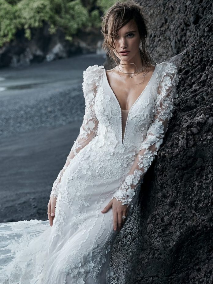 Bride on Beach Wearing Puff Sleeve Wedding Dress with 3-D Lace Floral Motifs Called Cruz by Sottero and Midgley
