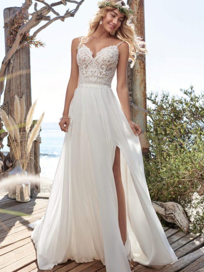 Bride on Beach Wearing Ivory Chiffon Wedding Dress Called Lorraine by Rebecca Ingram