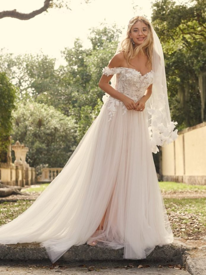 Bride wears boho A-line wedding dress with 3-D flowers called Mirra by Maggie Sottero