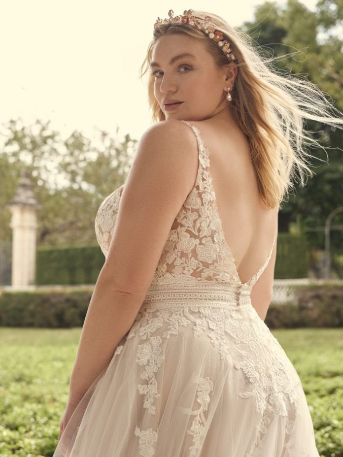 Bride Wearing Plus Size Wedding Dress by Maggie Sottero and Pearl and Floral Bridal Crown Called Calaveras by A'El Este x Maggie Sottero