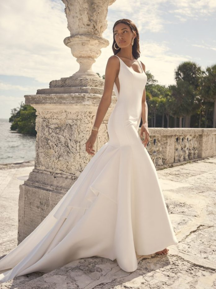 Bride wears luxe satin mermaid wedding dress called Kitara by Sottero and Midgley