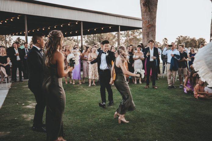 Bridesmaids and groomsmen dance at the wedding reception at Vineyard Wedding