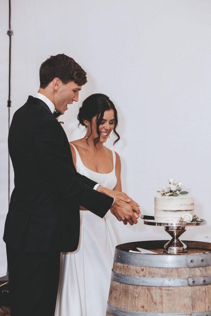 Bride and Groom cut a chocolate wedding cake at Vineyard Wedding