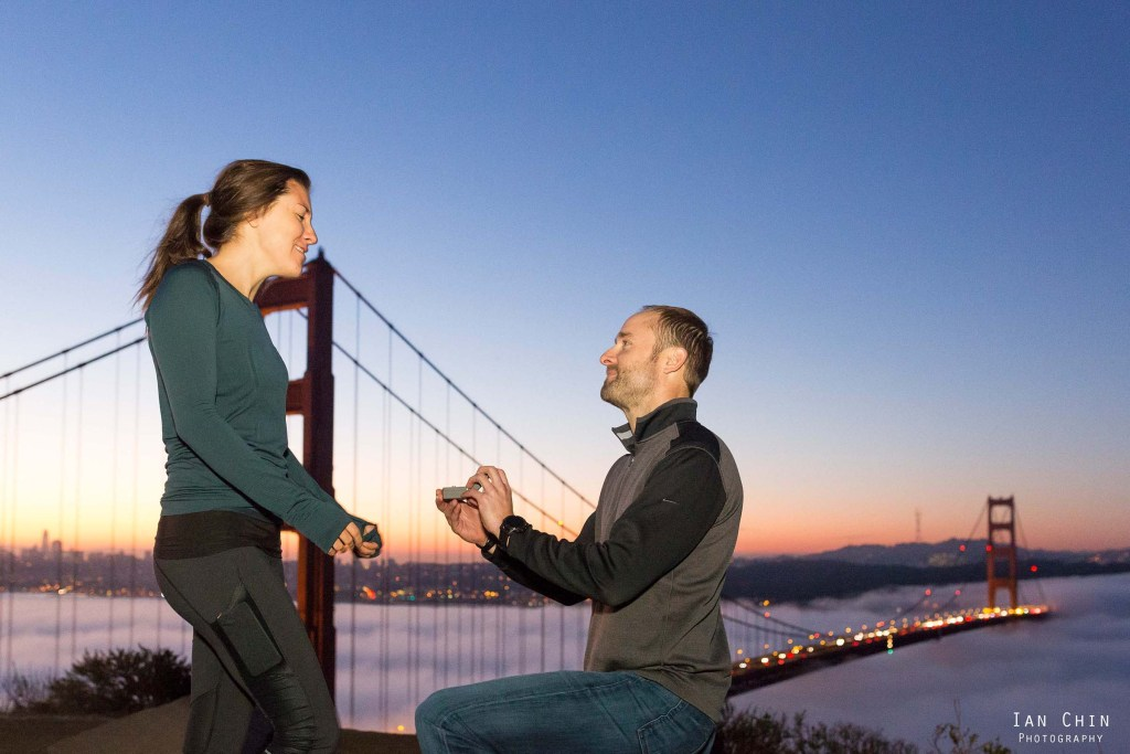 battery spencer sunrise marriage proposal with the girl wearing a green shirt and the golden gate bridge in the background